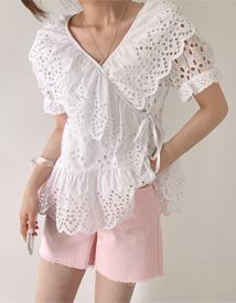 Punching wrap blouse